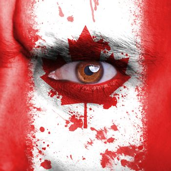 Canada flag painted on angry man face