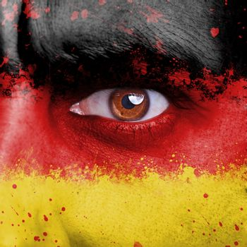 Germany flag painted on angry man face