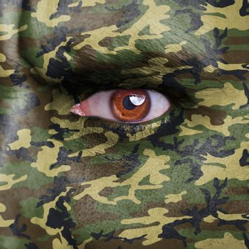 Army camouflage painted on angry soldier face