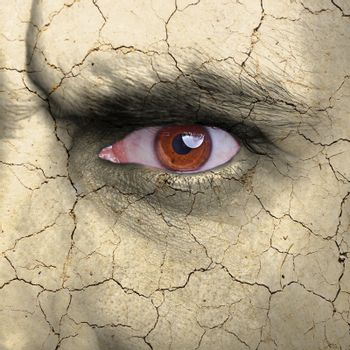 Beauty concept - face covered with cracked surface - symbol of dry skin