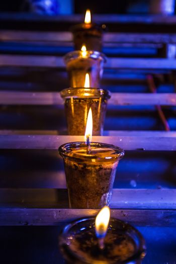 Closeup of burning candles in the Catholic Church