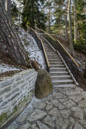 Beautiful staircase in the park leading up.