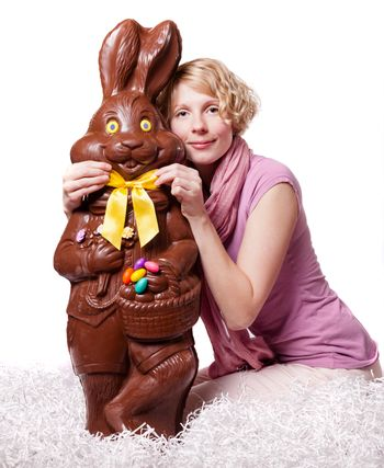 Blond Girl Adjusting Bowtie of a Chocolate Easter Bunny