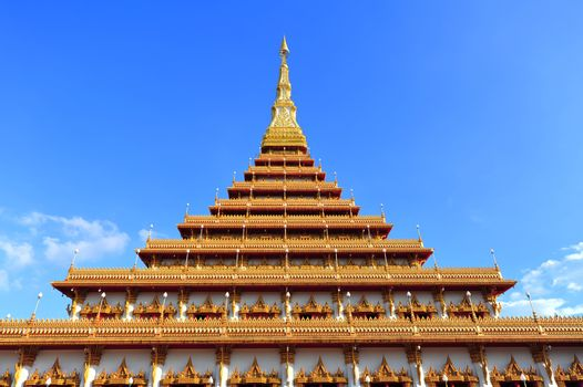Golden pagoda blue sky in Thailand