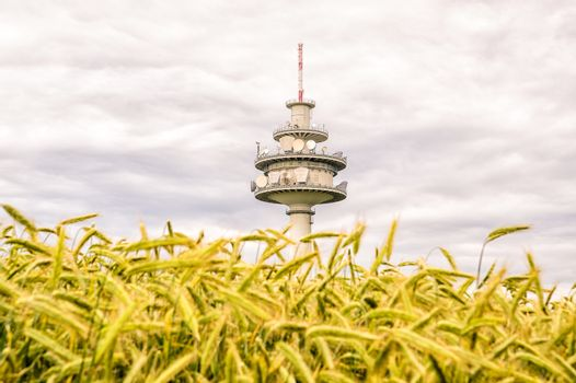 Telecommunication tower behind a field