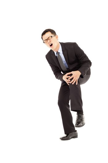 businessman have  the knee pain and painful expression