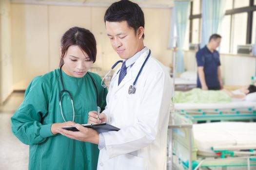 doctor and assistant are discussing  girl situation