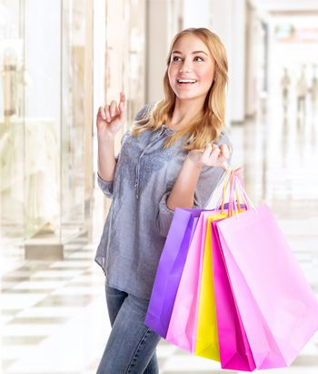 Happy female with shopping bags