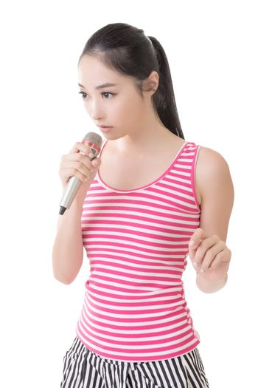 Asian girl take a microphone singing or speak