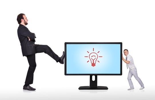 two businessman pushing big monitor with lightbulb