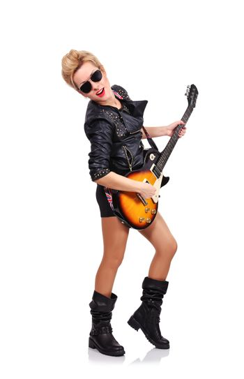 young rock girl playing on electric guitar