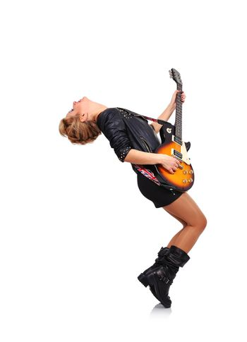 rock star girl with glasses playing on electric guitar