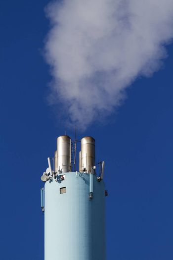blue chimney with clear sky and smoke