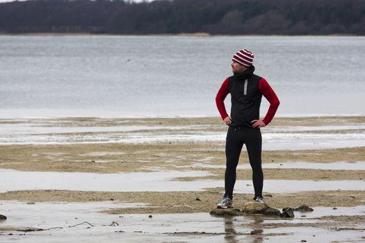 A man jogging at the sea at winter