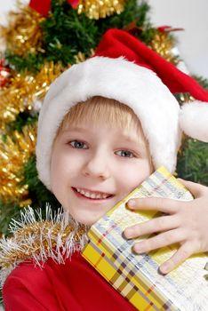 Small Santa Klaus with gifts