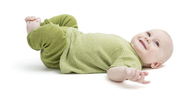 happy toddler isolated on white background. green clothing