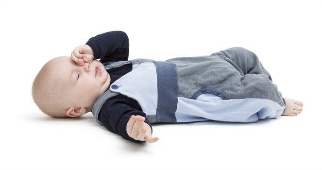 pooped baby isolated on white background. blue clothing. horizontal image