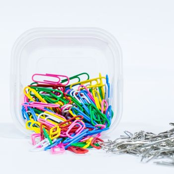Multi-color and chrome paper clip on white background