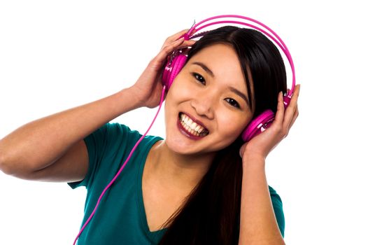 Adorable girl listening to music