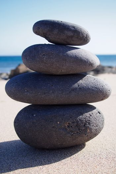 Zen-like stone pyramid on the beach
