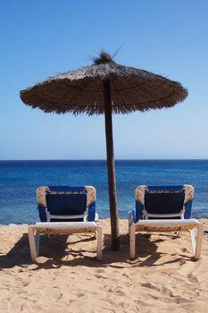 Beach chairs on perfect sand beach
