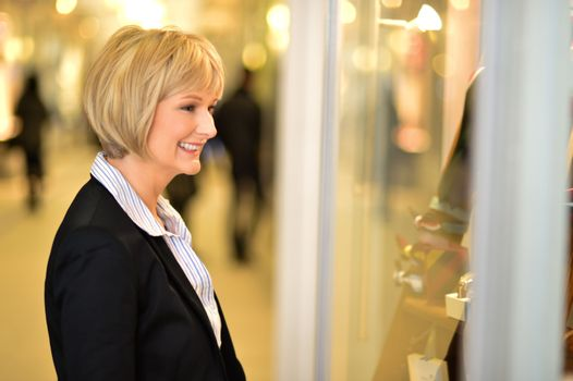 Businesswoman in front of a store window