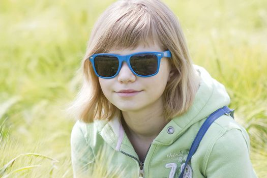 portrait of a little girl in the field of barley