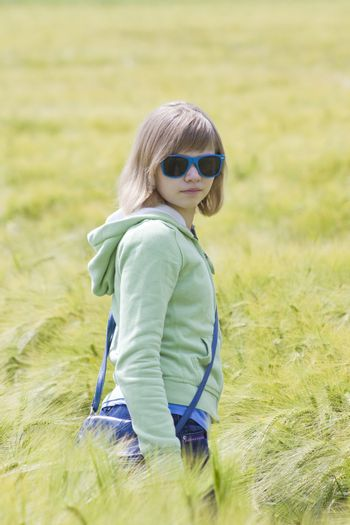 portrait of a little girl in the field of barley