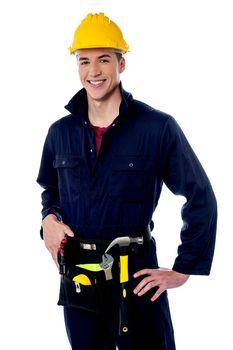 Smiling handyman on white background