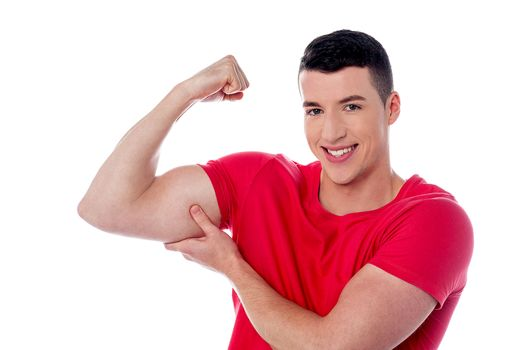 Fitness man showing bicep muscles