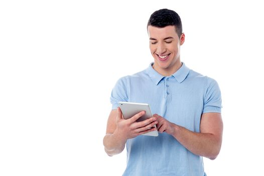 Young man using his tablet pc