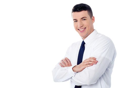 Happy young man with arms crossed
