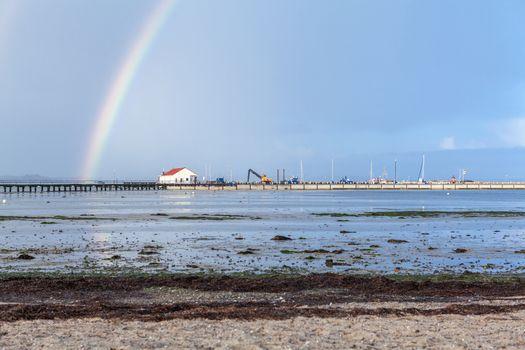Rainbow over tidal mud flats at the coast