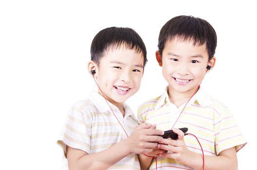 Cute children listen to music