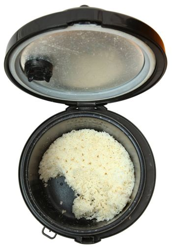 Top View Used Rice Cooker with White Rice, Over White