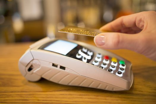 Female hand wallet payment shop