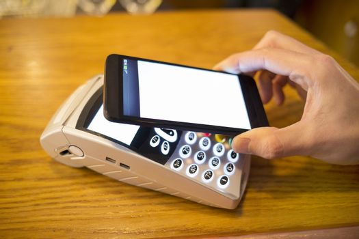 Male hand smartphone wallet payment shop