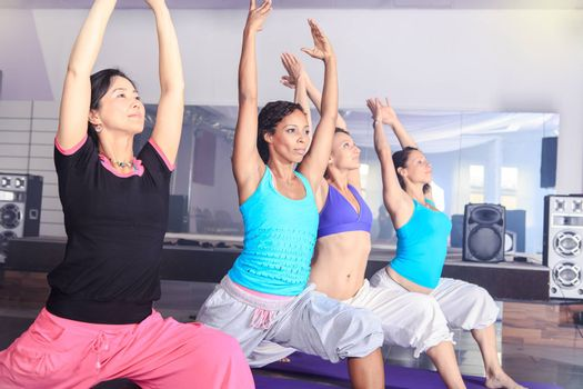 young women in sport dress at yoga exercise