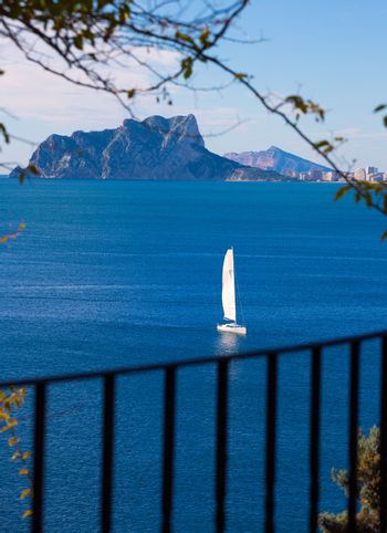 Ifach Penon view of calpe and Sailboat from Moraira in Mediterranean Alicante at Spain