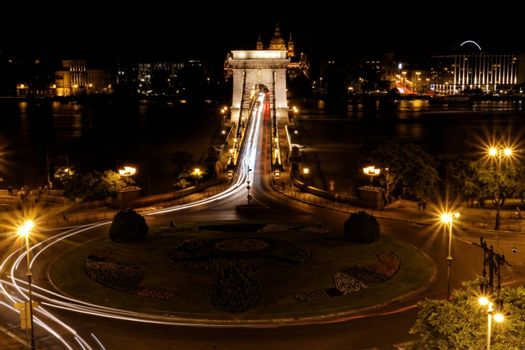Public transport on the Suspension Bridge at night in Budapest