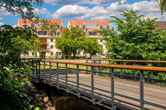 Bridge and renovated houses at Norrkoping town. Ostergotland, Sweden