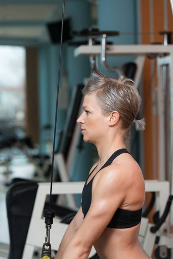 Beautiful Fit Woman Exercise Triceps In The Gym