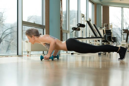 Beautiful Fit Woman Doing Push-ups In Healthy Club