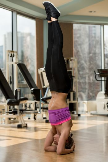 Young Attractive Girl Doing The Headstand