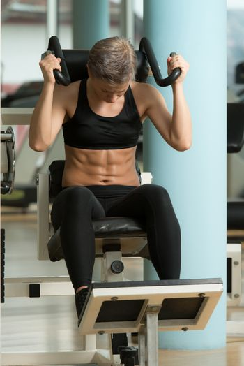 Attractive Woman Athlete Performing Exercise For Abdominal Muscl