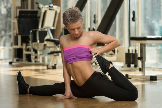 Fitness Woman Stretching On The Floor