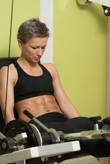 Fitness Woman Exercising Her Legs On Machine