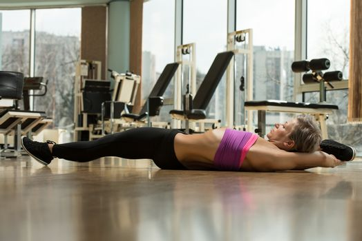 Fit Woman Stretches Before Exercise