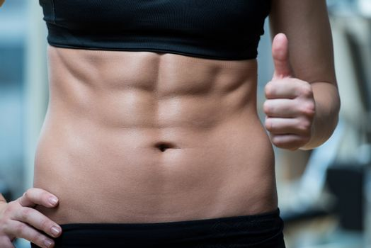 Beautifu Woman Showing Thumbs Up And Her Ab