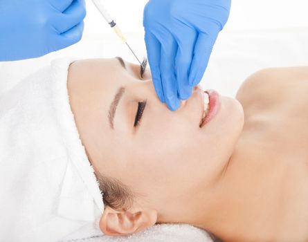 Woman is doing cosmetic surgery injections